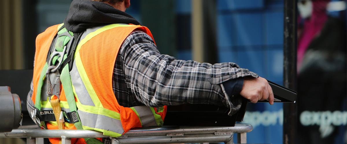 Construction worker handling metal